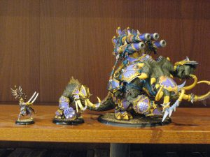 Scale shot.  From left to right, a human-sized figure, a heavy warbeast, and the Mammoth.
