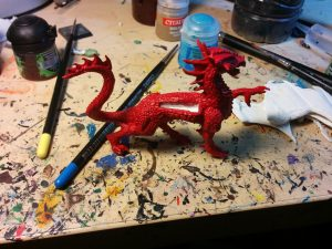 Here's the dragon slathered with his cherry-red basecoat.